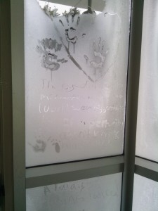 Graffiti on icy campus window