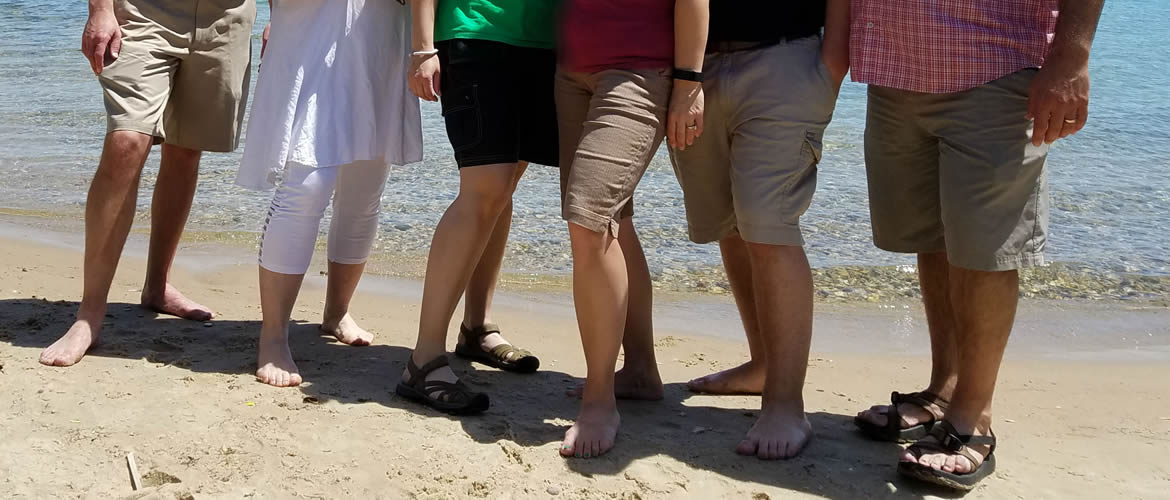 Image of EMT wearing shorts at the beach.