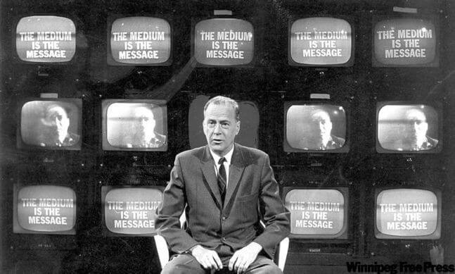 Marshall McLuhan - the medium is the message, displayed on a wall of TVs